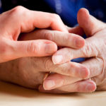 caregiver and parent holding hands
