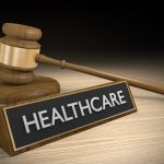 Healthcare sign in front of gavel