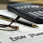 Estate Planning paperwork with glasses and calculator on a desk