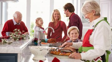 family preparing holiday dinner together