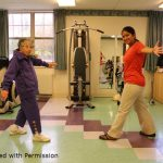 Older woman doing Big physical therapy movements