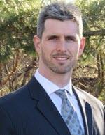 male attorney head shot outside
