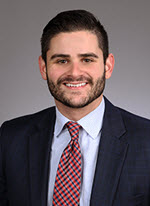Young male lawyer head shot Justin Scott