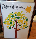 Tree with leaves painted on a whiteboard, allowing people to write bucket list items on it