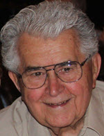 Picture of the authors father, he has grey hair, glasses and a beautiful smile