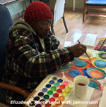 African American woman painting at ARTZ Philadelphia