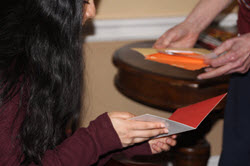 Young adult woman looking at cards with an older man