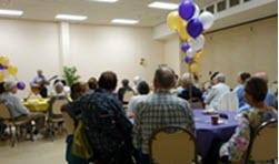 Seniors attending a memory cafe