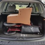SUV trunk with a wheelchair and steps to get into a car