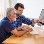 man teaching senior technolog