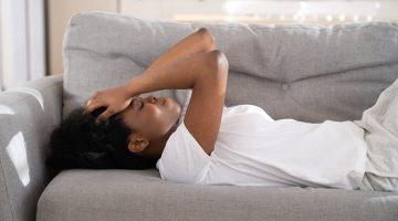 depressed sad woman lying down