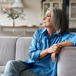relaxed mature older woman sitting thinking